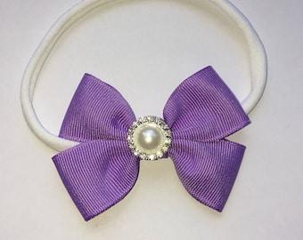 Handmade lilac bow on a dainties nylon headband