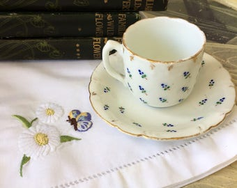 A 19th Century English Bone China Coffee Cup and Saucer
