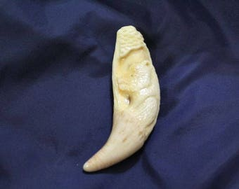 The tooth of a bear carved