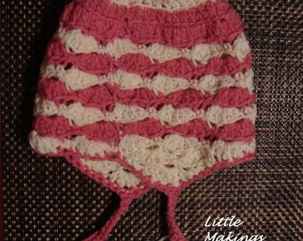 Earflap pom pom hat.Spring hat. Hat with tassels.