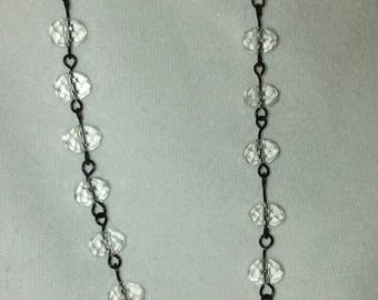 Black metal and clear crystal necklace