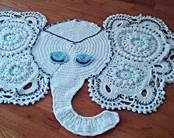 Hand beaded, meditating elephant