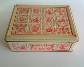 Beautiful Tin in vanilla-yellow-red with flowers, windmills and ship motif, vintage