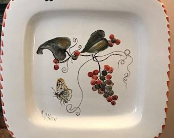 Glazed ceramic decorative plate