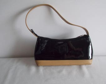 Special:    A black vinyl clutch / hand bag