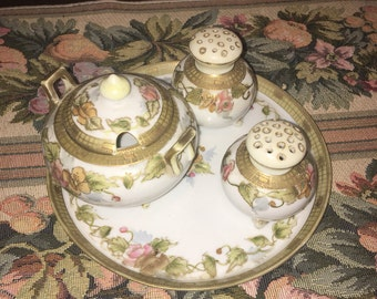 Antique Nippon porcelain salt ,pepper, and sugar biwl with matching tray. Hand painted . Excellent !