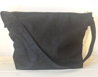 Black waxed canvas shoulder bag ruched sides zipped green lining