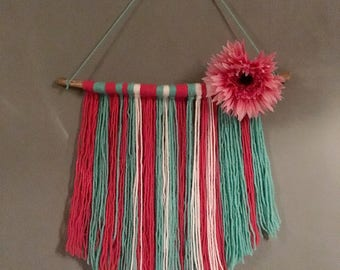 Wood and wool wall hanging with flower