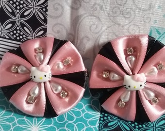 Hello kitty pink and black hair clip