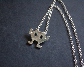silver tone space invaders necklace