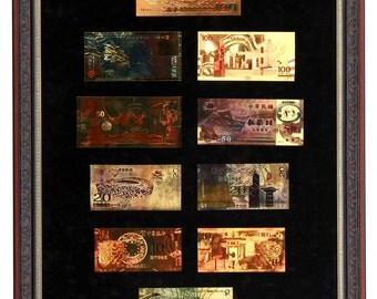Gilded Chinese Renminbi banknotes in frame