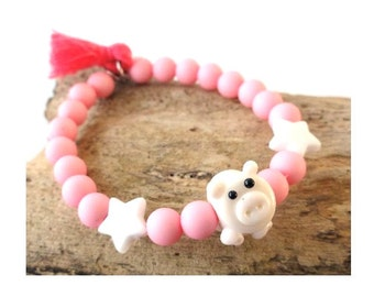 Cute bracelet for a child with an handmade glass piglet