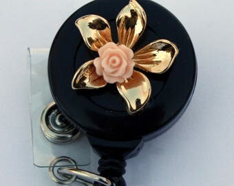 gold toned and pink flowers badge reels badge reel badge holders