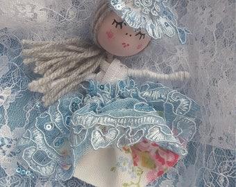 Handmade tiny bead doll