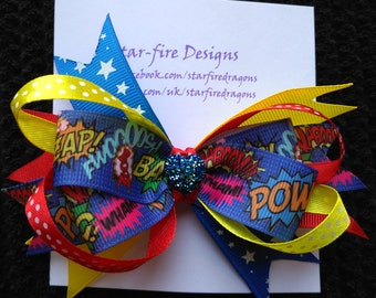 Super hero hair clip ~ Comic book hair bow ~ Super Girl boutique bow ~ Big and bright hair clips ~ Funky hair accessories! ~ Handmade in Uk