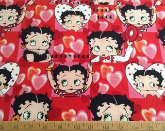 1 and 1/3 yards of Betty Boop/heart shapes cotton fabric