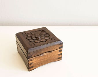 Small wooden jewelry box.