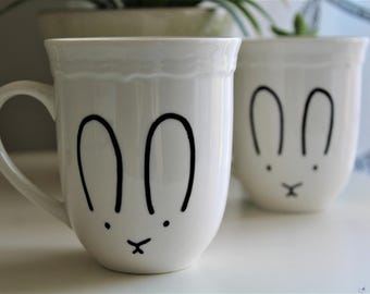 Coffee cups decorated by hand with reasons rabbits