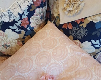 Decorative pink lace pillow cover. Zipper closure