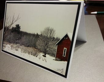 Snowy barn with black matting