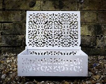 White memory box with lovely ornaments.