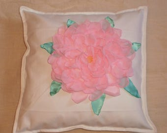 White pillow case with flower application