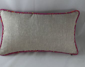 Linen lumbar cushion with pink piping