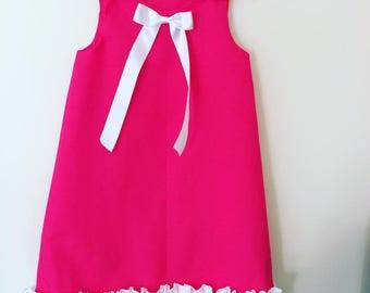 girls pink pinafore dress with ruffles