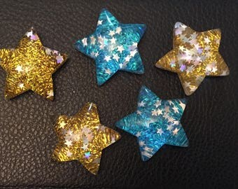 5 large resin flat back stars