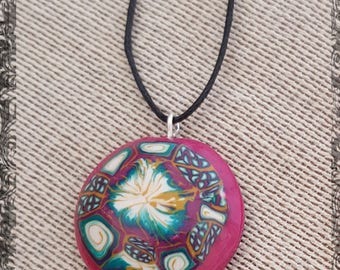 Multi-coloured, polymer clay crafted pendant. Silver-plated eye for the black adjustable cord.