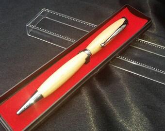 Hand turned wooden slimline twist pen, maple with chrome trim.