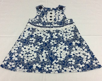 Baby dress in Navy and White flower print with trim detail