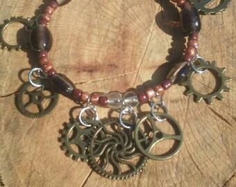 Boho hippy bracelet.Gears steampunk. Glass beads. 8 inch. Memory wire.