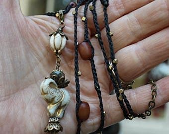 Ivory amber and brass bohemian knotted beaded wrap elephant focal necklace FREE domestic shipping