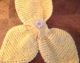 Keyhole knitted ascot scarf, sunny yellow with daisy brooch
