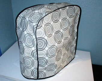 KitchenAid mixer cover in modern pattern, black, grey and tan.