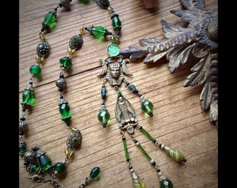 Pharoh and Mummy Egyptian Revival Art Deco Green Glass and Brass Lavalier Necklace by Louise Black