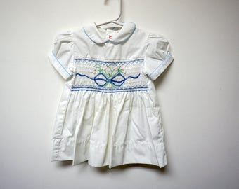 Orient Express . hand smocked white baby dress . size 1 . fits like  9 to 12 months