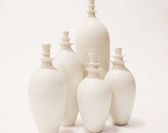 Made to order-  grand set of 5 white matte stoneware flanged vases by sarapaloma