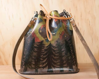 Drawstring Backpack - Leather Bucket Bag in the Stars Pattern with northern lights, trees and stars - antique black with turquoise and pink