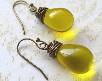 Earrings yellow  czech glass teardrop beads with antique gold wire wrapping
