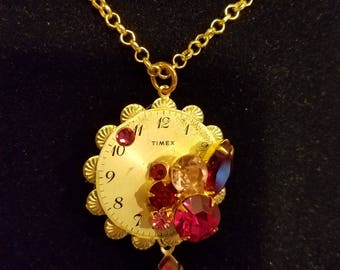 Time stands still with Magical Magenta, Purples, and Lavender shades in this Steampunk Pendant
