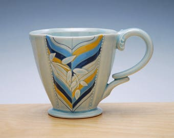 Chevron Deluxe clover cup in Frost gloss w. Blues & Tangerine dots and detail, Victorian mod