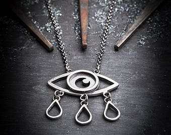TRISTESSE crying eye necklace