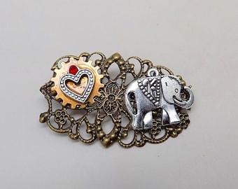 Steampunk jewelry. Stempunk elephant heart and gear brooch.