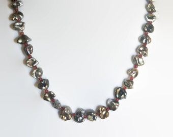 Tahitian Keshi pearls and Garnets