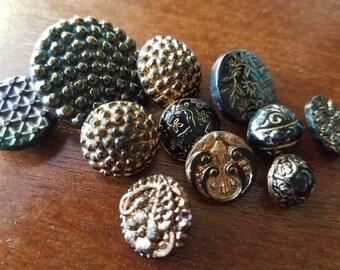 Vintage buttons, 11 assorted bronze/ gold luster over black glass, Victorian pressed designs (mar 220 17)