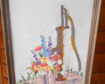 Vintage old fashioned well with bucket of flowers Needlepoint