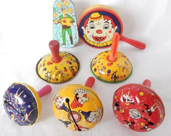 vintage noise makers, tin lithographs, Kirchhof noisemakers, wooden handles, dancers, clowns, vintage toys, party supply