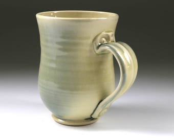 Wheel thrown pale yellow and gray pottery mug with screw hardware handle